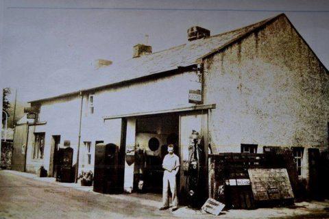 Man outside garage or workshop