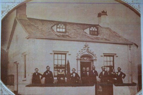 Gentlemen gathered outside a house